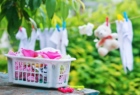 laundry line: baby clothes on rope in the garden