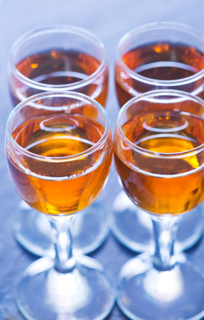 cognac: cognac in glass and on a table