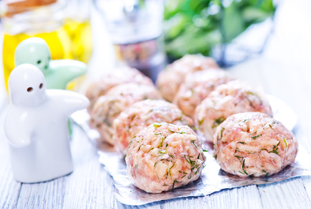 cooked pepper ball: raw meat balls with spice on the foil Stock Photo