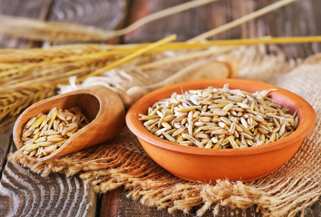 dry  oat in bowl and on a table Stock Photo - 60888691
