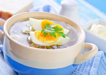 sour grass: green soup with boiled eggs