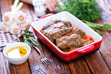 farci: dolma with sauce in the bowl and on a table Stock Photo