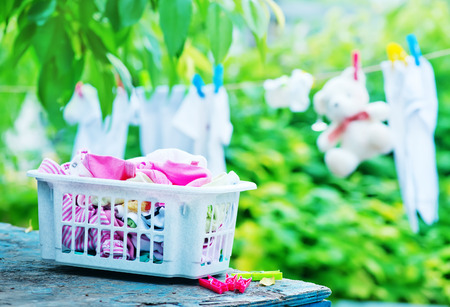 sully: baby clothes on rope in the garden