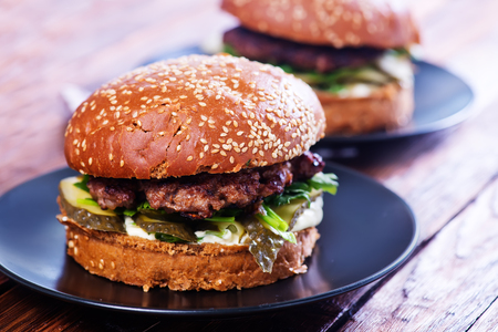 red quinoa: burgers on plate and on a table