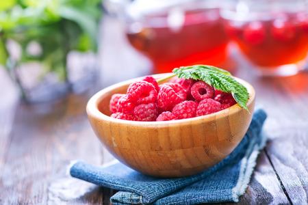raspberry tea and fresh berries on a table