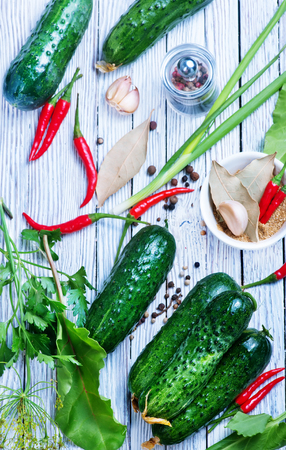 fresh cucumbers with salt and spice on the wooden table Stock Photo