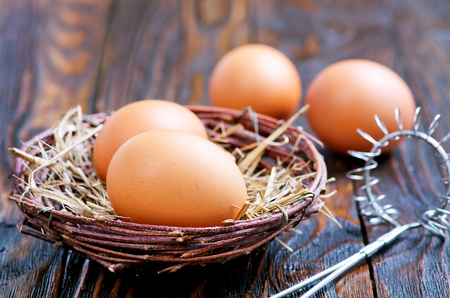 raw chicken eggs on the wooden table