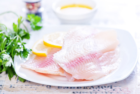 fish fillet on plate and on a table