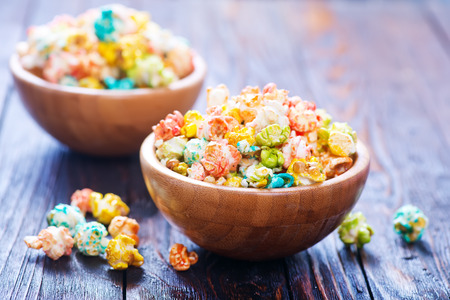 color popcorn in bowls and on a table Imagens