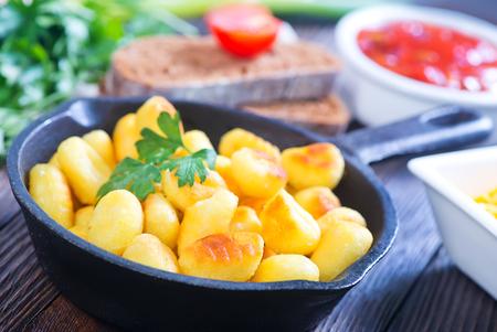 potato gnocchi with sauce on the kitchen table