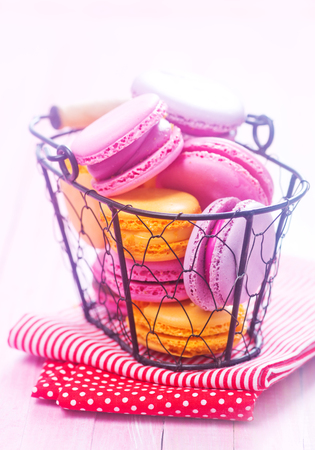 lavender coloured: color macaroons in basket and on a table