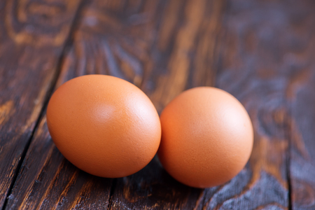 duck egg: raw chicken eggs on the wooden table