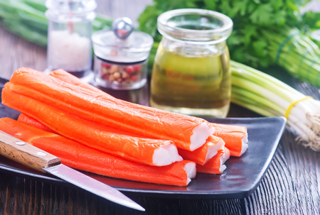 crab sticks on plate and on a table Stock Photo
