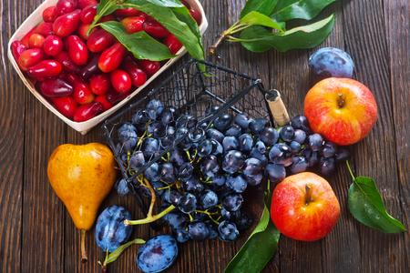 autumn harvest on the wooden table, autumn fruits Stock Photo
