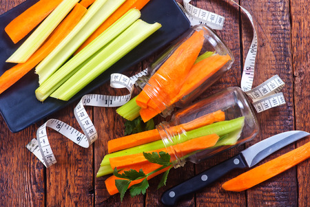 celery with carrot on plate and on a table