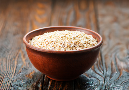 oat bran in bowl and on a table