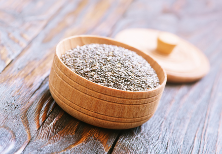 Chia seeds in bowls and on a table
