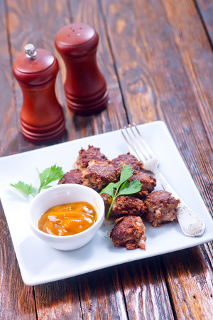cooked pepper ball: meat balls with sauce on the plate Stock Photo
