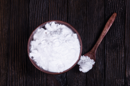 neutralizer: baking soda in bowl and on a table Stock Photo