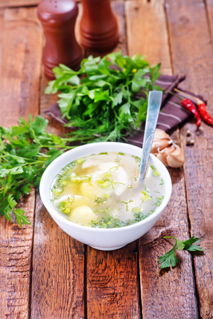 chicken soup in bowl and on a table Stock Photo