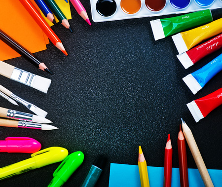 school supplies on the table, color paint and pencils