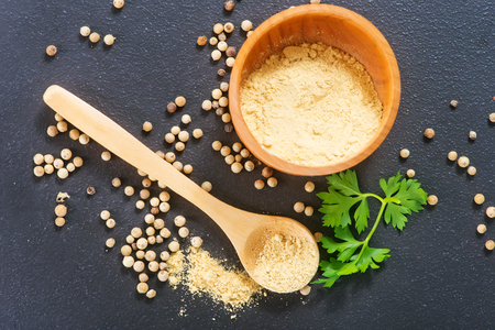aroma bowl: white pepper on a table, aroma spice in bowl