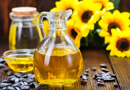 sunflower oil and sunflower seeds on a table Stock Photo