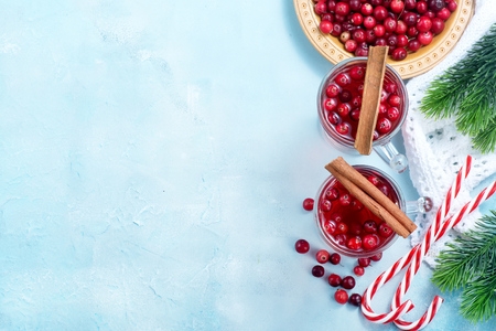 degustation: cranberry drink and berries, christmas drink in glass and on a table