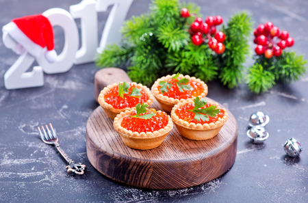 red salmon: canape with red salmon caviar on the wooden board