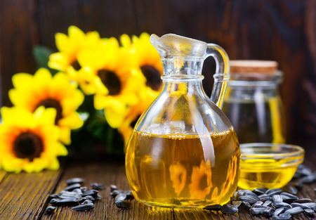 sunflower oil and sunflower seeds on a table