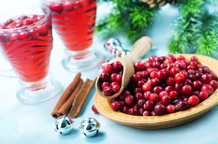 cranberry drink and berries, christmas drink in glass and on a table