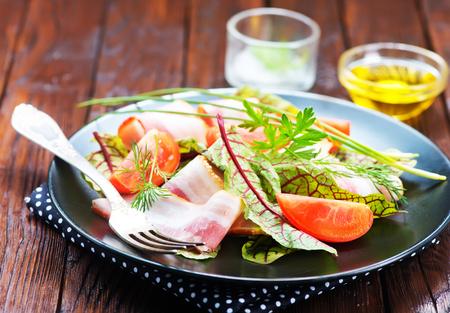 sausage pot: fresh salad on plate and on a table