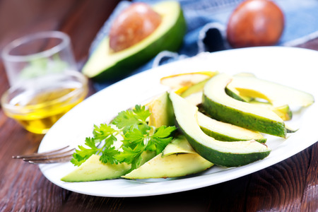 agrarian: avocado salad on white plate and on a table