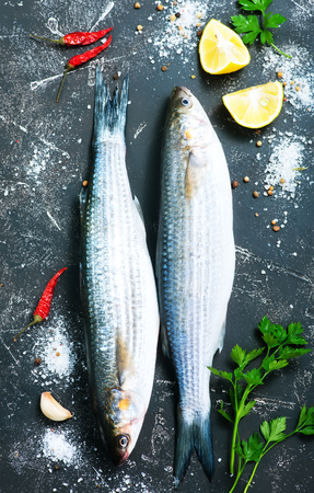 brown trout: raw fish with aroma spice on a table Stock Photo