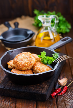 cutlets: chicken cutlets with spice and fresh greens Stock Photo