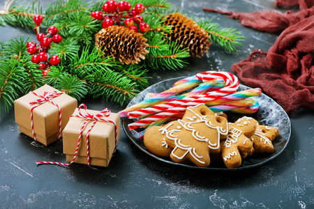 cookies and candy cane on a table