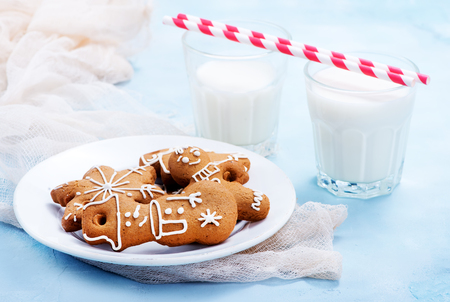 cookies and candycane on a table, christmas background Stock Photo