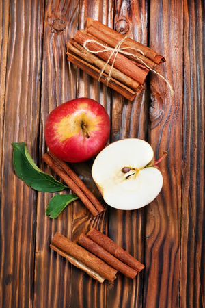 fresh apples with cinnamon on a table