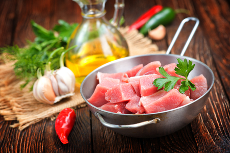 raw meat in pan and on a table Stock Photo
