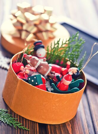 christmas decoration in the golden box and on a table Stock Photo