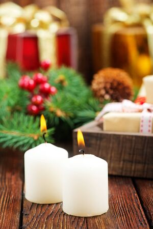 candles with ribbon on a table, christmas decoration Stock Photo