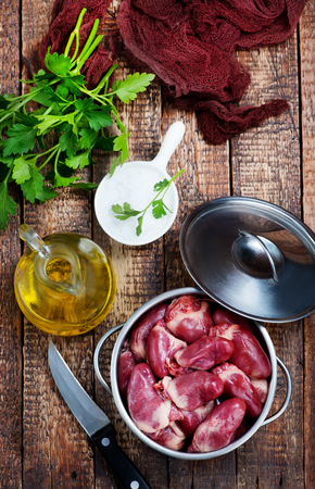 duck hearts in bowl and on a table Stock Photo