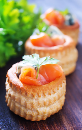 tartalets with salmon and butter on a table