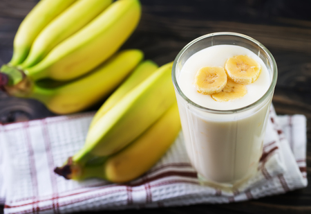 banana yogurt in glass and on a table