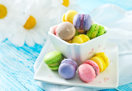 color macaroons in bowl and on a table
