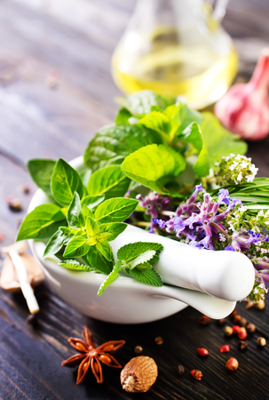 asian flavors: fresh herbs and aroma spice on a table Stock Photo