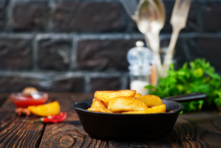 fried potato with salt and spice on a table Stock Photo
