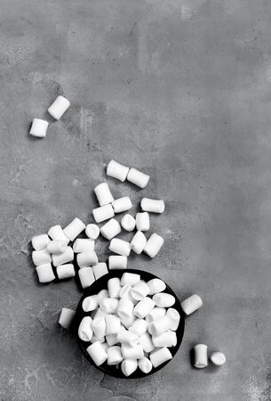 spongy: marshmallow in bowl and on a table Stock Photo