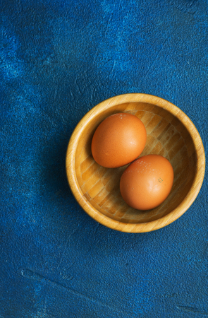 raw chicken eggs on the kitchen table,