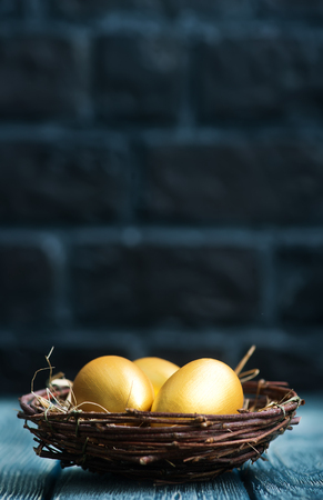 golden eggs, easter eggs on a table